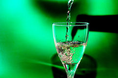 Pour it into a glass of wine Royalty Free Stock Photo