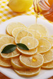 Pour honey lemon slices Royalty Free Stock Image