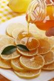 Pour honey lemon Royalty Free Stock Photos
