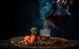 Pour hot tea into a glass. Food composition Stock Photo