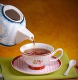 Pour the hot tea Stock Photo
