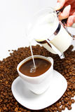 Pour milk in coffee stock photos