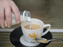 Pour Milk In Coffee Royalty Free Stock Photos
