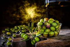 Freshly harvested fresh olives photographed on an antique wooden Royalty Free Stock Image