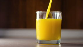 Pour the orange juice into a transparent glass, HD footage. Pouring the orange juice into a transparent glass stock video