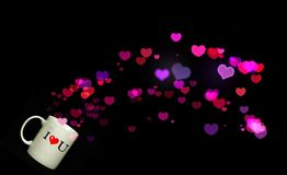 Pour Out Luv. Image of Coffee Cup Pouring out Colorful Hearts Stock Image
