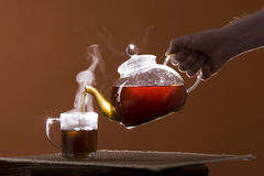Pour out tea Stock Photography