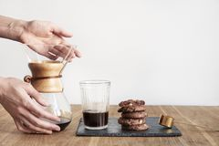 Pour Over Coffee Brewing Method Chemex, Woman Hands Hold A Glass Bowl, Still Life With Brownie Cookies On Wooden Table. Royalty Free Stock Photography