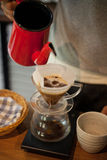 Pour Over Coffee Drip Brewing. He is pouring over Coffee Drip Brewing in his hand Royalty Free Stock Photography