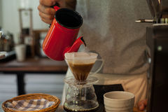 Pour Over Coffee Drip Brewing. He is pouring over Coffee Drip Brewing in his hand Royalty Free Stock Images