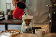 Pour Over Coffee Drip Brewing. He is pouring over Coffee Drip Brewing in his hand Stock Image