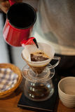 Pour Over Coffee Drip Brewing. He is pouring over Coffee Drip Brewing in his hand Royalty Free Stock Photos