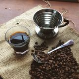 Pour Over Cup of Coffee and Beans Stock Photos