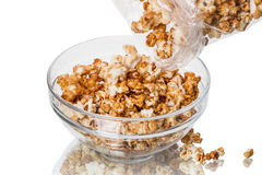Pour the popcorn into a bowl Royalty Free Stock Image