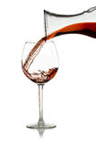 Pour red wine from a decanter Royalty Free Stock Images