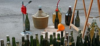 Pour red wine from the demijohn to bottles. Pour red wine from the demijohn to glass bottles Stock Photography