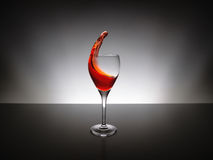 Pour red wine on glass Royalty Free Stock Image