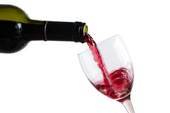 Pour red wine in glass Royalty Free Stock Image
