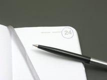 Pour renverser un agenda de rendez-vous ouvrez-vous Photo stock