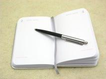 Pour renverser un agenda de rendez-vous ouvrez-vous Photo libre de droits