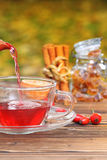 Pour in rose hip tea Royalty Free Stock Images