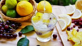 Pour soda water into a glass making detox water drink stock footage