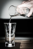 Pour some fresh clean water. Into glass with jug Stock Photo