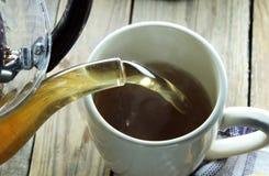 Pour Tea into a Cup Stock Images