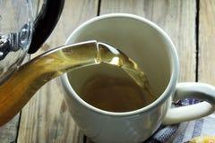 Pour Tea into a Cup Royalty Free Stock Photos