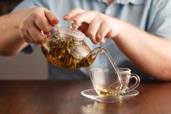 Pour tea into cups Stock Photo