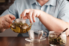 Pour tea into cups Royalty Free Stock Images
