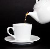 Pour Tea From The Teapot Into The Cup Stock Photos