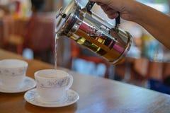 Pour tea. To pour tea into a cup of tea Stock Photos