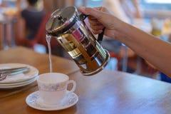 Pour tea. To pour tea into a glass of tea Stock Image