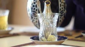 Pour tea from Turkish  teapot.  Drinking Turkish. Pour tea from Turkish  teapot. Drinking traditional Turkish Tea. Turkish tea in traditional glass cup stock video