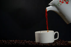 Pour up in coffee into a cup Royalty Free Stock Photo