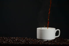Pour up coffee into a cup Royalty Free Stock Images