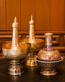 Pour water containers. Pour water golden containers used in Buddhist rituals Stock Photo