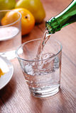 Pour the water. Pour fresh water into the glass Stock Photography