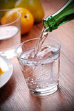 Pour the water. Pour fresh water into the glass Royalty Free Stock Image