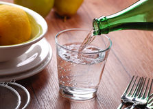 Pour the water. Pour fresh water into the glass Royalty Free Stock Images