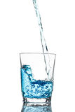 Pour water in glass isolated Stock Image