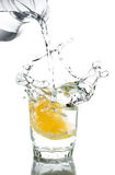 Pour water in glass with lemon Stock Photos
