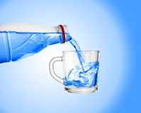 Pour water into a glass royalty free stock photo