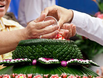 Pour water on the hands and ask for blessing. Pour water on the hands of revered elders and ask for blessing is Thai culture when someone who retire or new year' Royalty Free Stock Images