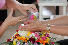 Pour water on the hands of revered elders and ask. For blessing Royalty Free Stock Images