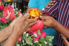 Pour Water On The Hands. Of revered elders and ask for blessing in Songkran festival tradition of Thailand Stock Images