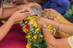Pour water on the hands. Of revered elders and gives blessing in Songkran festival stock photos