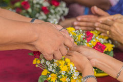 Pour water on the hands. Of revered elders and gives blessing in Songkran festival Royalty Free Stock Photos