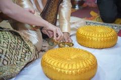 Pour water in Thai wedding. Pouring water in Thai wedding Stock Photos
